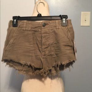 Free People beige button fly cut- off shorts